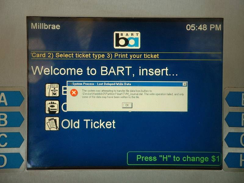 "A BART ticket machine showing a Windows ""System Process"" error"